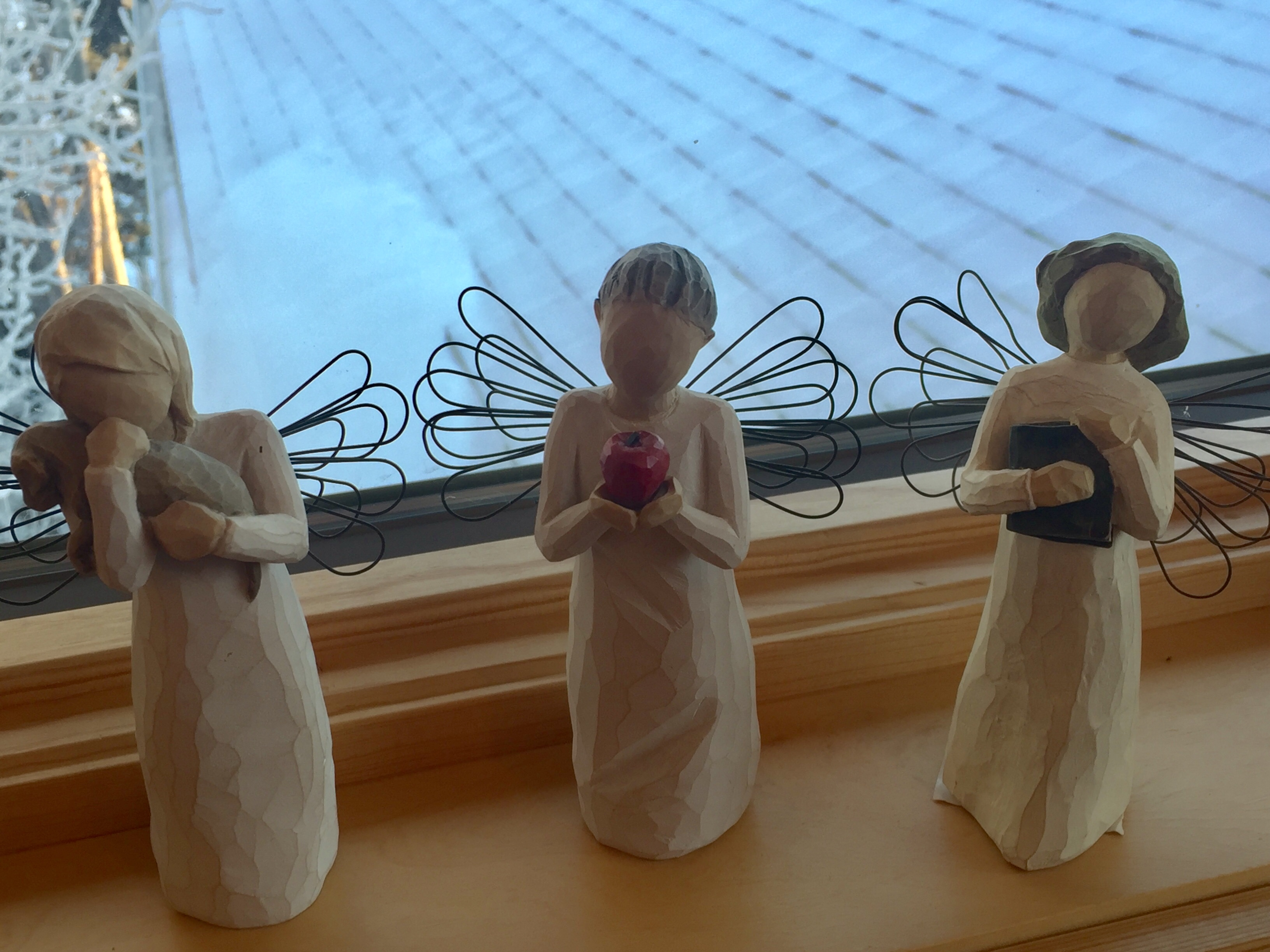 3 angels on ledge.jpg