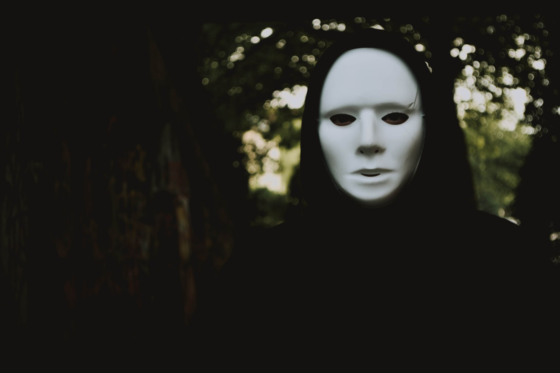 selective focus photography of person wearing mask