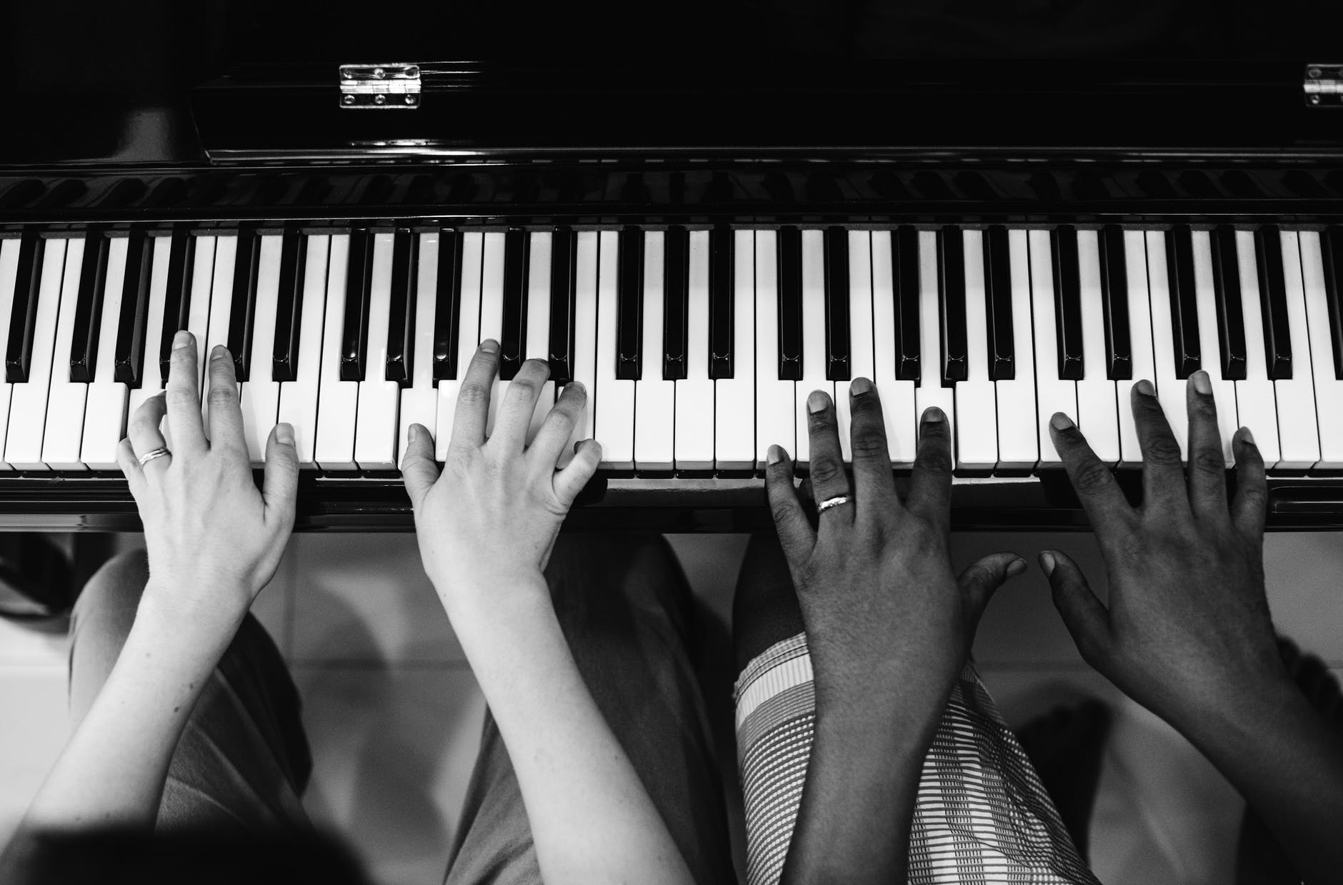 monochrome photography of people playing piano