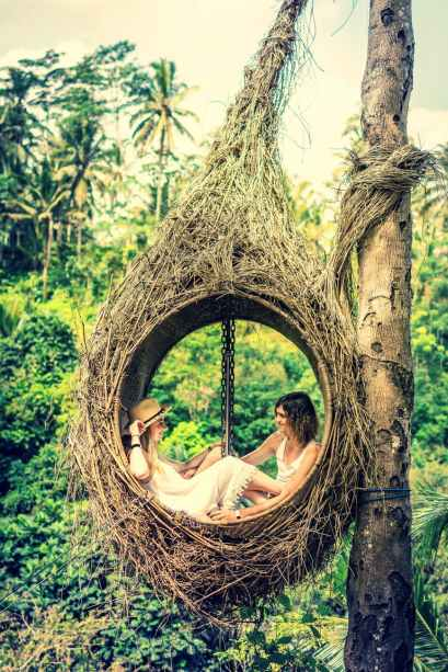photo of couple sitting on hammock