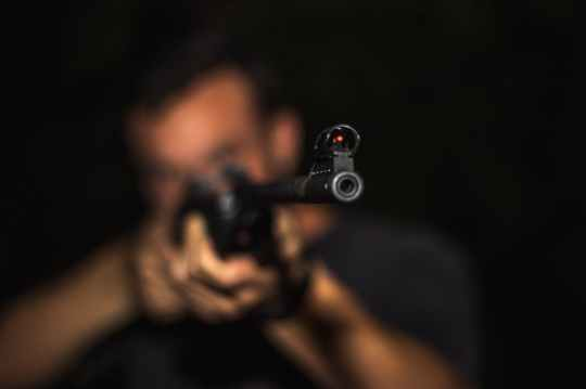 photo of man holding rifle