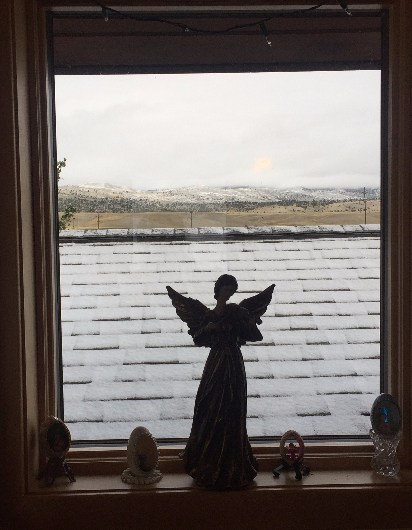 angel-in-snowy-window.jpg