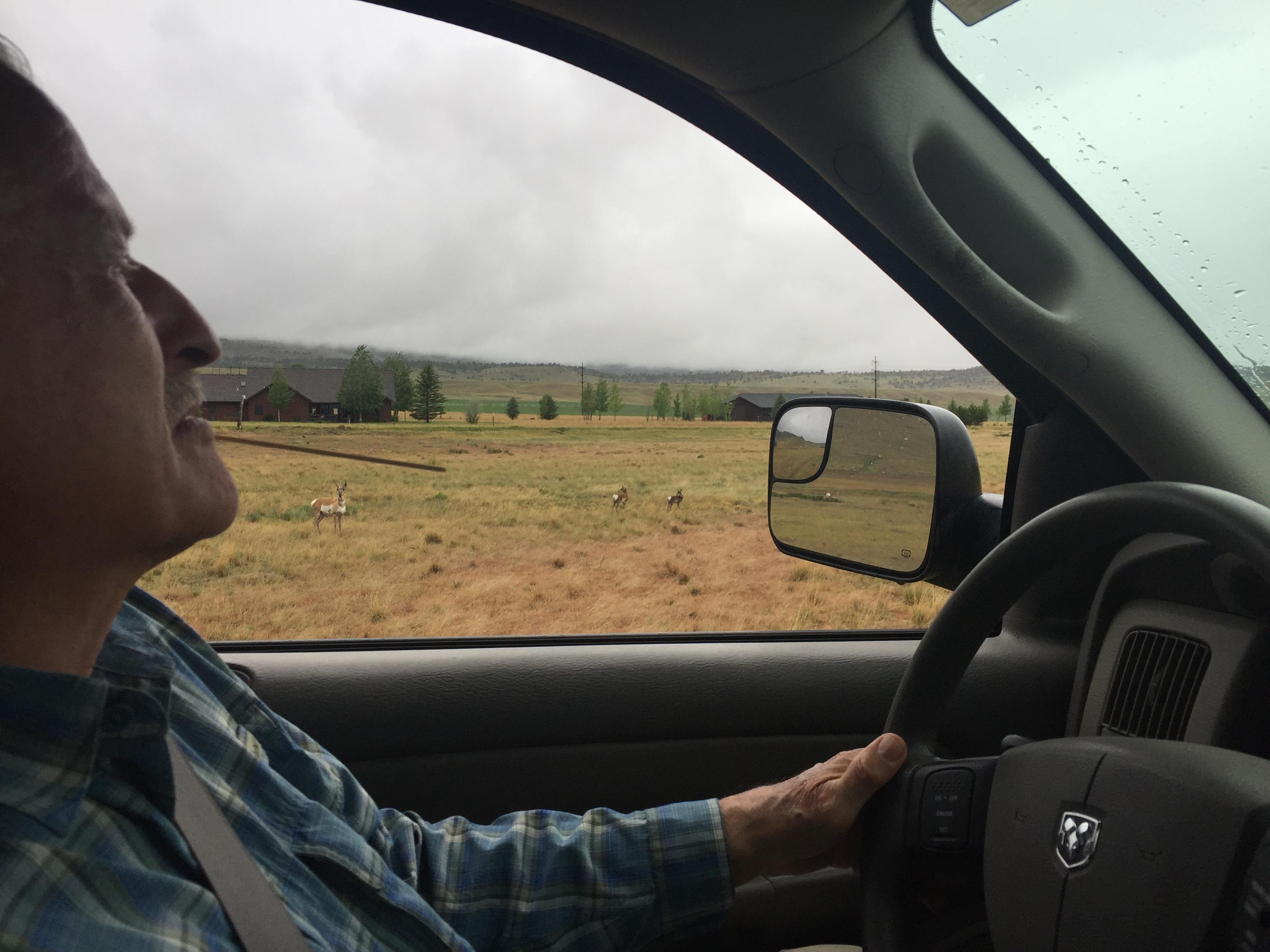 Bob w antelope in field.JPG
